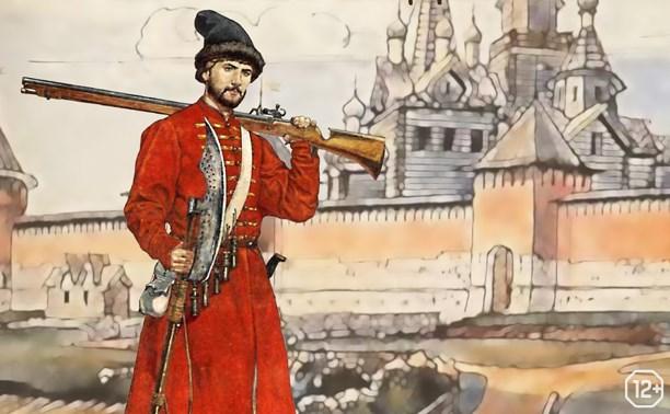 Ружье, сапог и берендейка