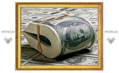Доллар на ММВБ вырос сразу на полрубля