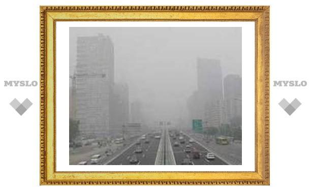 С улиц Пекина уберут 60 тысяч такси и автобусов