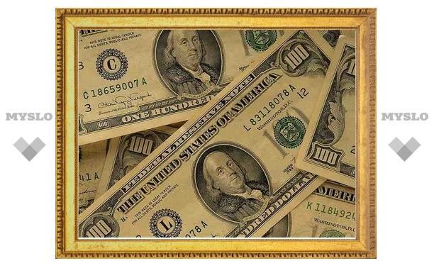 Ухудшение прогноза по рейтингу США подняло курс доллара в России