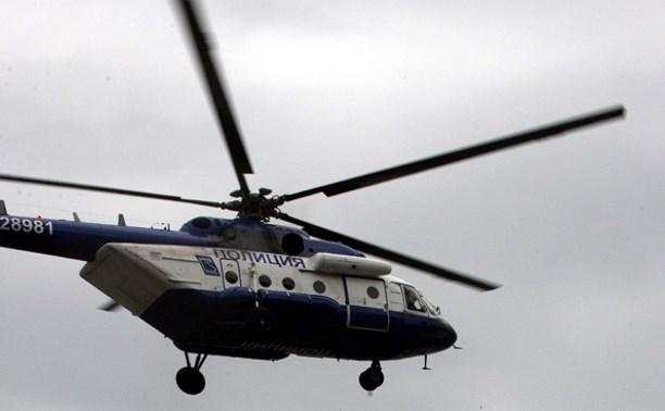 Стрелявшего в полицейского мужчину разыскивают с помощью вертолета