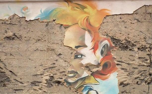 Граффити «Летающий мальчик» на Первомайской уничтожено из-за утепления дома