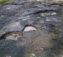 Юрий Андрианов потребовал срочно ликвидировать ямы на дороге в центре Болохово