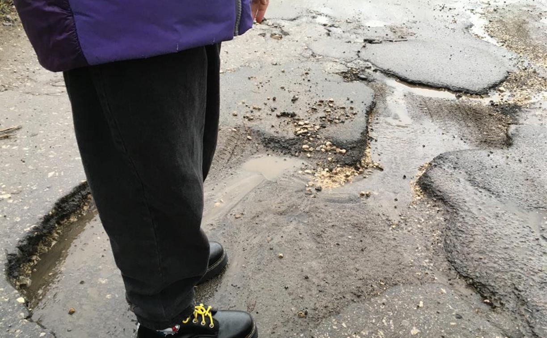 Ямы на улице Седова: «Вот такой ширины! Вот такой глубины!»