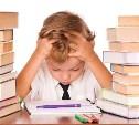 Количество учебников в российских школах сократят до трех