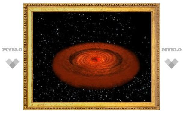 Сверхмассивную черную дыру застали во время трапезы