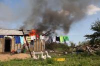 С огнем в жилом доме в селе Теплое боролись три пожарных расчета, Фото: 25