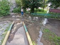 В Пролетарском районе Тулы затопило улицы и дворы: вода хлещет из колодцев, Фото: 12