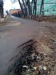 Асфальту нет и года ул.Немцова между домами 21 и 23, Фото: 1