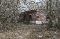 С заброшенных очистных канализация много лет сливается под заборы домов, Фото: 24