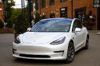белая Tesla, Фото: 1