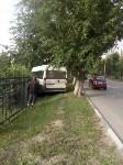 На улице Кирова микроавтобус снес забор, Фото: 6
