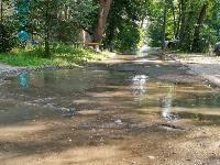 В Пролетарском районе Тулы затопило улицы и дворы: вода хлещет из колодцев, Фото: 10