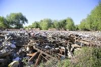 Незаконную свалку на берегу Тулицы спрятали под грудой земли, Фото: 11